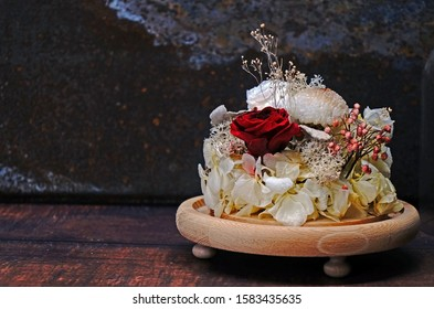 Eternity red rose and white Hydrangea flowers in crystal dome for room decoration during Valentine's day. DIY (Do It Yourself) of dried flowers, Idea for room interior. Selective focus with copy space