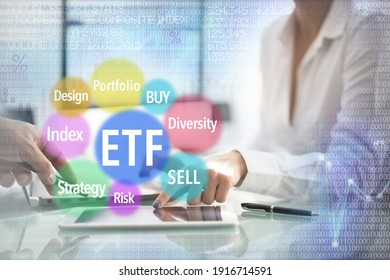 ETF Investment index funds concept with business woman hand showing graph evolution of stocks on a tablet