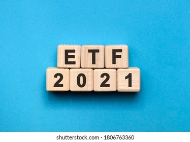ETF - text concept on wooden cubes with gradient blue background