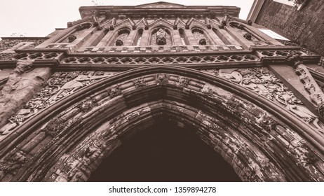 The Ethelbert Gate low angle, Norwich historical landmark, medieval gate split toning