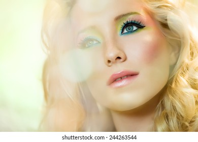 Ethereal young woman with colorful make-up.