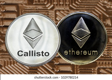 Ethereum and Callisto coins on gold circuit background. Cryptocurrency ETH CLO.