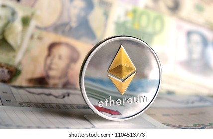 Ethereum coin against of different banknotes on background. Cryptocurrency Trading concept .