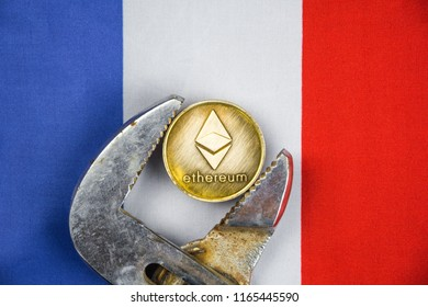 Ethereum coin being squeezed in vice on France flag background; concept of cryptocurrency ethereum (eth) under pressure. Prohibition of cryptocurrencies, regulations, restrictions or security