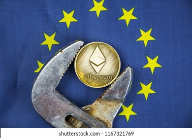 Ethereum coin being squeezed in vice on European Union flag background; concept of cryptocurrency ethereum (eth) under pressure. Prohibition of cryptocurrencies, regulations, restrictions or security