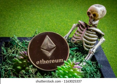 Ethereum coin in a graveyard and a skeleton.