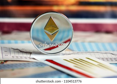 Ethereum coin  on graph and diagrams  background. concept of trading  crypto currency