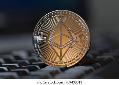 an ethereum coin on a keyboard