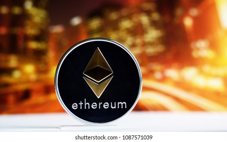 Ethereum coin over colorful background