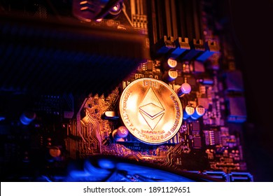 Ethereum Cryptocurrency coin on a PC computer motherboard, crypto currency mining concept. - Shutterstock ID 1891129651