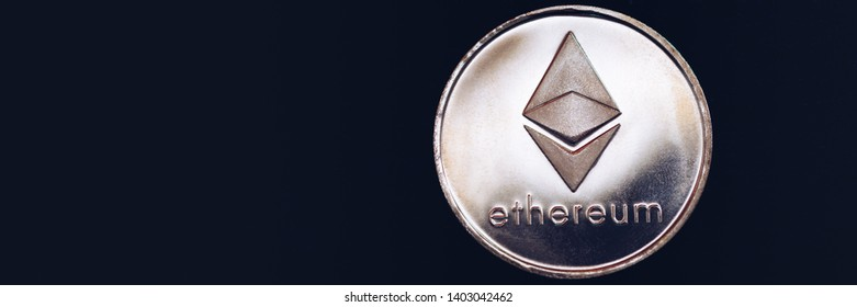 Ethereum cryptocurrency (crypto currency). Silver Ethereum coin with gold Ethereum symbol. ETHEREUM (ETH) cryptocurrency.