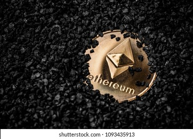 Ethereum cryptocurrency golden coin on black background