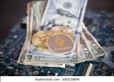 Ethereum Cryptocurrency on US Dollars with Computer Motherboard. Electronic Virtual Currency Exchange Concept.