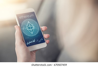 Ethereum crystal symbol on mobile app screen with graphs and charts with copyspace on the right. Learning about ethereum growth concept. New virtual money.