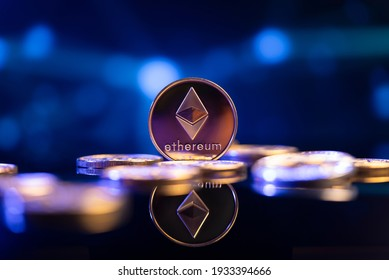 Ethereum (ETH) cryptocurrency coin in front of an abstract blue virtual background