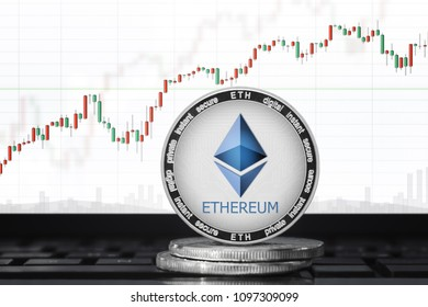 ETHEREUM (ETH) cryptocurrency; ethereum coin on the background of the chart