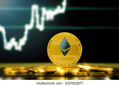 ETHEREUM (ETH) cryptocurrency; gold ethereum coin on the background of the chart