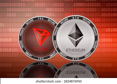 Ethereum ETH and Tron TRX coins on the binary code background; ethereum and tron cryptocurrency