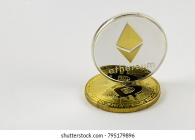 etherium stand on golden bitcoin isolated on white