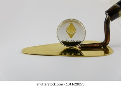 etherium stand on golden trowel