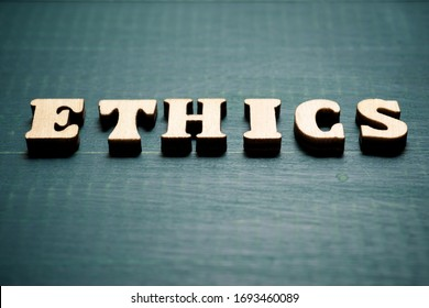 Ethics word on a wood table.