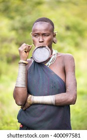 Ethiopia, 9 / November / 2015, Surma tribe: Surma women are famous for their traditional lip plate. Traditional living in Ethiopia. Documentary Editorial Image.