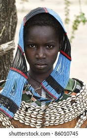 ETHIOPIA - AUG 10: Tsemay woman posing in the village,the ethnic groups in the The Omo valley Could disappear Because of Gibe III hydroelectric dam. on Aug 10, 2011 in Omo Valley, Ethiopia.