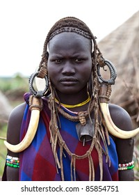 ETHIOPIA - AUG 11: Unidentified Mursi woman posing in the village, the ethnic groups in the The Omo valley Could disappear Because of Gibe III hydroelectric dam on Aug 11, 2011 in Omo Valley, Ethiopia.
