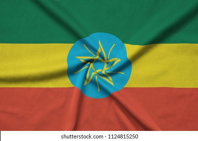 Ethiopia flag  is depicted on a sports cloth fabric with many folds. Sport team banner