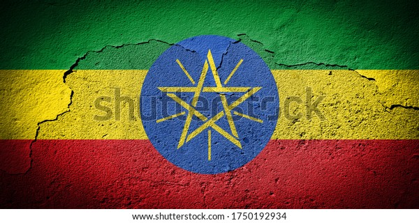 Drapeau éthiopien peint sur un mur grunge fissuré