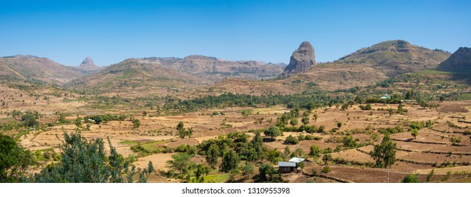 ETHIOPIA, harvested  fields in a valley between Bahri Dar and Gondar, surrounded by bizarre rock formations as a result of volcanic activities
