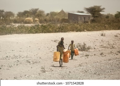 Ethiopia, Jigjiga 2016 Children who are thirsty in their homes due to drought in Africa. They carry water to their homes in canisters.