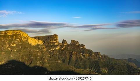 Ethiopia. Simien Mountains National Park. Imet Gogo peak bathed in sunrise light