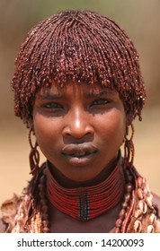 ETHIOPIA - UNKNOWN: A young African girl wears traditional attire as she stands for a portrait in this undated image taken in Ethiopia.