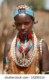 ETHIOPIA - UNKNOWN: A young female tribal member wearing traditional attire poses for a portrait in this undated image taken in Ethiopia.