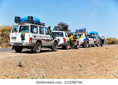 ETHIOPIA,DANAKIL-CIRCA  JANUARY 2018--unidentified  people and car in the land of afar people