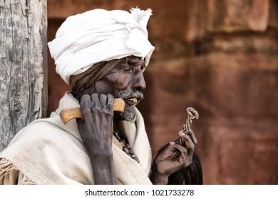 ETHIOPIA,LALIBELA-CIRCA  JANUARY 2018--unidentified priest praying  in the genna celebration
