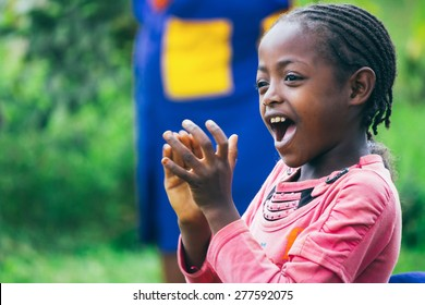 Ethiopian girl singing and clapping during a party