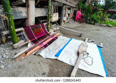 Ethnic Batak ulos weaver in Toba lake of the Samosir Island, Sumatra, Indonesia. Batak stands for the ethnic people living in the northern part of Sumatra Island of Indonesia.