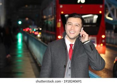 Ethnic businessman walking the city street at night