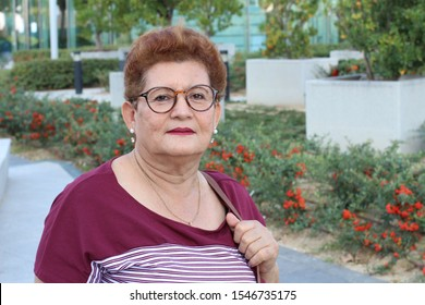 Ethnic grandmother looking at camera