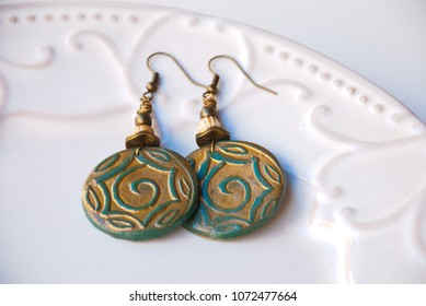 Ethnic green gold earrings. Handmade jewelry polymer clay. Fashionable bijouterie.