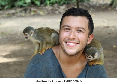 Ethnic man with Titi monkeys on his shoulder
