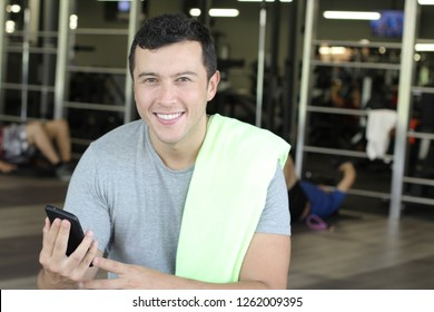 Ethnic man using fitness app with copy space