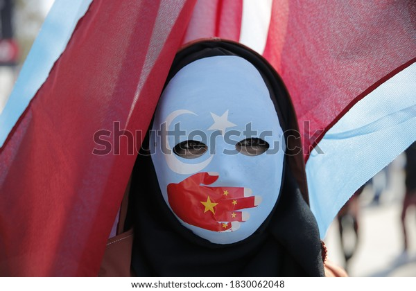 Ethnic Uighurs are seen during a protest against China near the Chinese Consulate in Istanbul, Turkey, December 15, 2019.