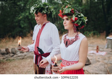 Ethnic wedding in national costumes. Ukrainian marriage of the Old Believers. Bride and groom in embroidered shirts. Ancient Ukrainian traditions. Khortytsia Island.