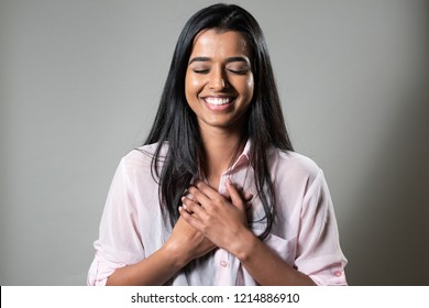 Ethnic Woman Happy, Holding Heart With Hands - Feels Loved