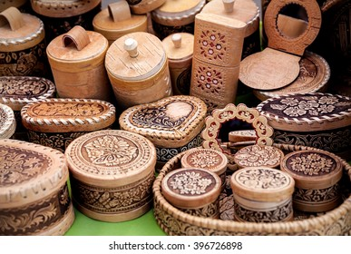 Ethnic wooden carved utensil and souvenirs in the market at Nauryz celebration in Almaty, Kazakhstan