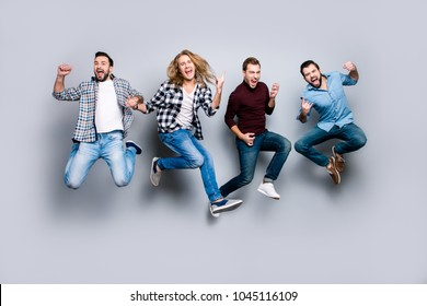 Ethnicity diversity careless freedom people chill hang-out figure playful funny showing symbols concept. Four excited cheerful active carefree men jumping up isolated on gray background