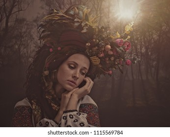 Ethno Beauty. Beautiful young woman in traditional ukrainian crown posing in forest